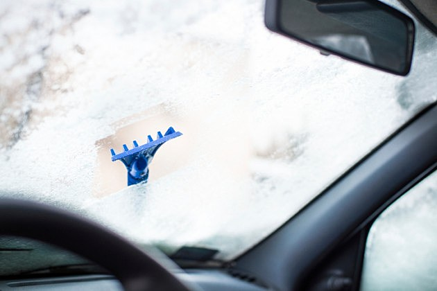 Ice Scraper on Windshield