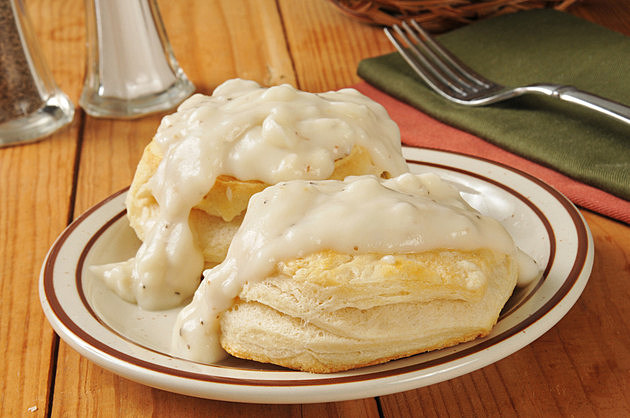 Fresh baked biscuits with country gravy on a rustic wooden table