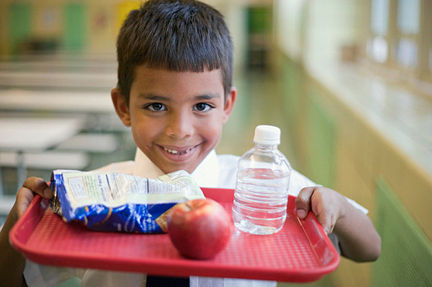 Boy with lunch tray in school cafeteria