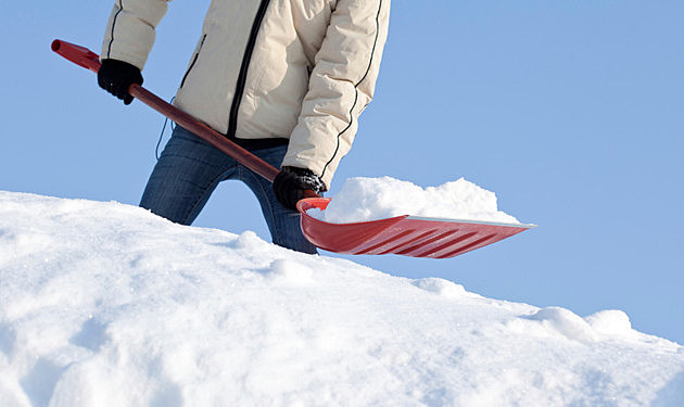 Removing snow with a shovel